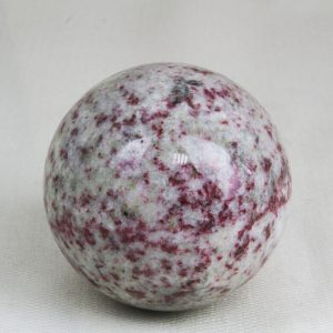 Highly polished and perfectly round sphere made from Cherry blossom stone (Cinnabrite) with 57 mm diameter