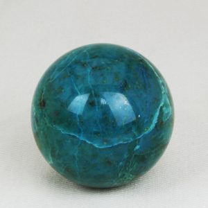 Highly polished and perfectly round sphere made from Chrysocolla with 49 mm diameter