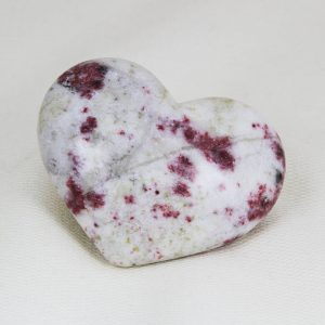 Beautiful heart with perfect shape and superior polish hand-made from cherry blossom stone (cinnabrite)