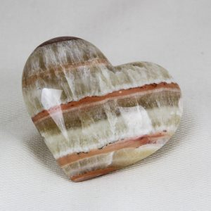 Beautiful hand-made heart with perfect shape and superior polish hand-made from premium grade fluorescent and phosphorescent pink aragonite