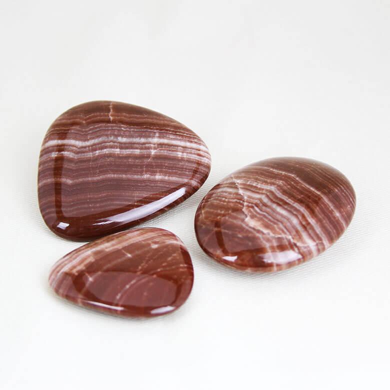 Red Aragonite palm stones