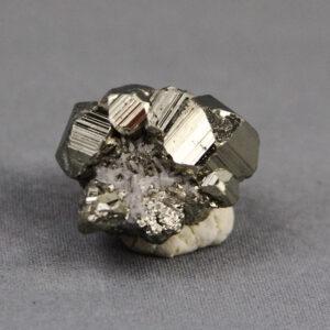 Pyrite and quartz crystal cluster from Huanzala mine in Peru